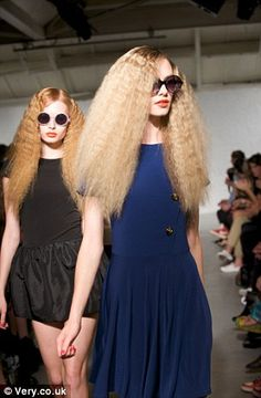 Cool, big 70s hair, crimped
