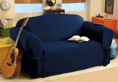 """Soft Micro Suede Solid Navy Blue Loveseat Cover Slipcover by Grand Linen. $29.95. Fabric Content: 100 % Polyester. Care Instruction: Machine Washable. Soft Suede Loveseat Slipcover. 1pc Loveseat Cover Fits most standard loveseats (60"""" ~ 75"""" ). BRAND NEW Loveseat slipcover in the absolutely gorgeous suede fabric. These covers are to fit loveseats that are 60"""" to 75"""" in length.  This upholstery infuses a room with a unique richness and sumptuous softness. This set achieves the sam..."""