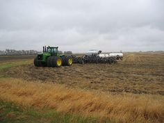 John Deere model 9400 4X4 tractor w/one-pass tillage equipment, planter and fertilizer applicator with tanks.