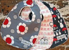 Baby Bibs for Baby Girl - Set of 3 - Grey & Red - Tossed Flowers, Stitched Hearts, and Bunnies with Toadstools - The Red Thread. $28.50, via Etsy.