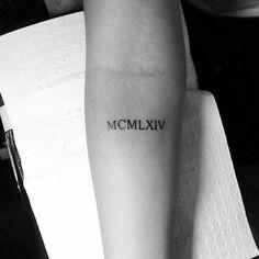 Tattoo römische Zahlen Unterarm eleganter Look