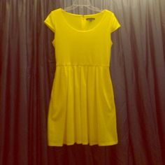Tiana B yellow patterned dress Great little summer dress with pockets! Fits true to size. I am a bit larger on top, 32 dd and it fits well. The bottom of dress is lined. Looks great with heels or flats. Hits me a little bit above the knee. Reasonable offers and questions welcome. Tiana B Dresses