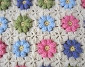 I like how puffy these flowers look amidst the crochet.