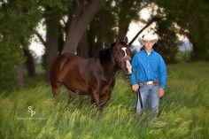 Senior boy with roping horse