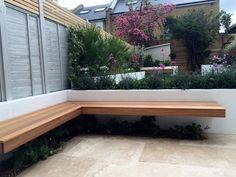 floating hardwood bench travertine paving raised beds brixton clapham streatham garden design designer london