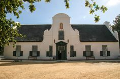 Take a step back in time and come and experience how our wines are made. Enjoy a 45-60 minute guided tour through our modern cellar, followed by a wine tasting and audio visual screening. African House, Cape Dutch, Wine Tasting Experience, Old Oak Tree, Space Place, Holiday Destinations, Cape Town, South Africa, Mansions