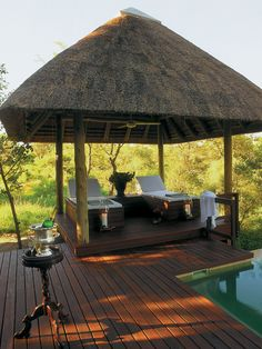 A private thatched gazebo outside each luxury room at Royal Malewane.