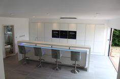 Simply stunning ALNO Bristol kitchen designed by Phil Harflett, featuring Corian worktops and raised breakfast bar