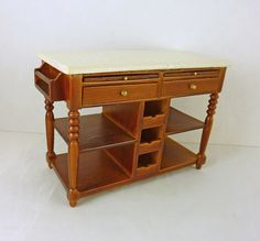"""Dollhouse Miniature Walnut Kitchen Island w Faux Marble, Drawers, =modern walnut wood dollhouse kitchen center island with faux marble counter top. There are drawers and pull out bread boards. The center niches do NOT pull out. The counter measures 4 1/8"""" wide x 3"""" tall x 2"""" deep in 1:12 scale.  Z"""