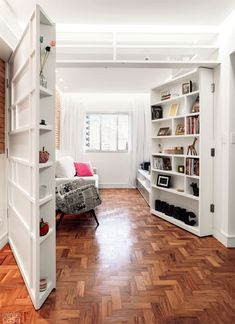 """Shelving Units on hinges close to create a """"guest room"""" out of the living room when necessary - or open and fold back against the walls to work as normal bookshelves in the space. """"doors"""" open in opposite directions and lay flat against diagonal walls (link contains more pictures)."""
