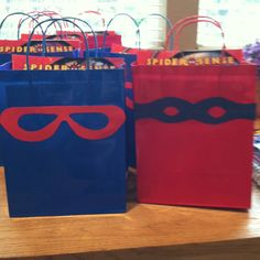 Home made super hero favor bags! Mask made of cardstock, hot glued to bags. My creation!