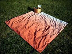 If she's outdoorsy: Spread a picnic lunch on this ombre blanket; when lunch is over, give the blanket to her as a gift.