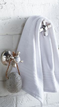 These taps don't turn on any water, but boy do they turn on the style. Each faucet cleverly makes a sturdy hook to hang your towel, robe, or pjs.