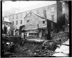Old house being torn down on a back lot, Bleecker Street and Greene Street, c1890. Photo by Jacob Riis. Photo from the Museum of the City of New York.