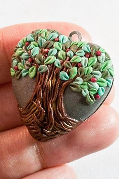 Polymer clay tree pendant, only I think I will make it on a circle instead of a heart.  Love it.