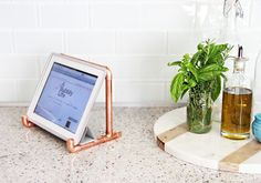 Copper Ipad Stand DIY and easy. made at A Bubbly Life blog. It is simple, minimal, and stylish or all iPads.