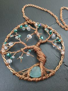 A personal favorite from my Etsy shop https://www.etsy.com/listing/531752107/tree-of-life-sun-catcher-wire-sun