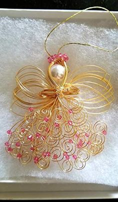 Beautiful, Elegant and handmade, hand formed gold or silver color Guardian angel made with Swarovski Emerald Crystals. Measures 4 tall x wide. Beautifully packaged in an organza pouch! Christmas Angel Decorations, Christmas Angel Ornaments, Easy Christmas Crafts For Toddlers, Xmas Crafts, Wire Ornaments, Beaded Angels, Angel Crafts, Wire Crafts, Christmas Jewelry