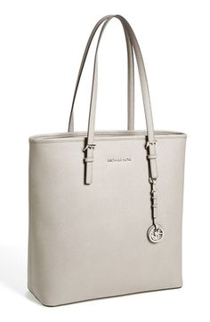 Free shipping and returns on MICHAEL Michael Kors North/South Saffiano Leather Tote at Nordstrom.com. Lavish Saffiano leather textures an elegant, versatile tote detailed with a dangling logo tag for a touch of gleam.