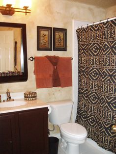 Bathroom featuring African Tribal Art and patterned mudcloth shower curtain.