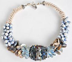Hand blown art glass choker with fresh water pearls.