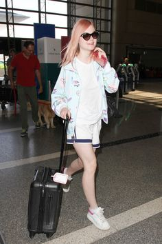 Elle Fanning is seen at LAX.
