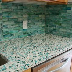 recycled glass counter with tile backsplash