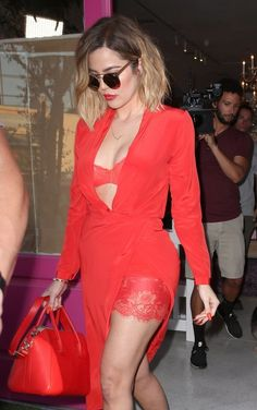 Khloe Kardashian Photos Photos - Khloe Kardashian Steps Out in Red - Zimbio