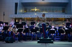 """Chief Warrant Officer 4 Robert A. Szabo conducts members of the Riverside Dinner Theatre and local soloists during thier performance of """"Can you hear the people sing"""" from the Brodway Musi …"""