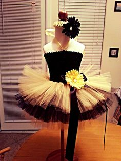 The bodice of this dress is lined with a stretchy jersey knit fabric for comfort and modesty. Tutu skirt is a knee length, 3 tier skirt - each layer