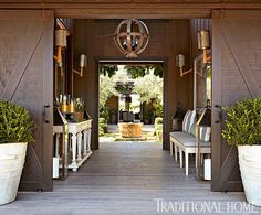 Walk through this entrance and you'll land directly in the open courtyard. - Photo: John Merkl / Design: Hillary Thomas