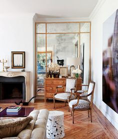 huge antiqued mirrors flanking fireplace