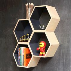 "Gray Hexagon Bookshelf | dotandbo.com Dimensions: 10 3/8""h x 12""w x 6'd Materials: layered solid birch plywood"