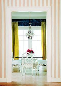 Vertical stripe wall | interior design by Celerie Kemble #dining room