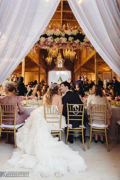 Outdoor barn wedding with chandeliers photo by www.jonathanivyphoto.com #bardwedding #barn #wedding