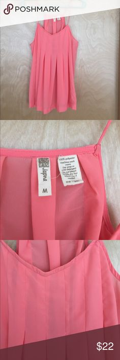 NWOT Size medium flowy coral pink tank top New without tags Size medium flowy coral pink tank top. This top has a very flattering flow. Brand is Japna. japna Tops Tank Tops