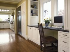Desk space with built in book shelves on the sides.  Great for a kitchen or home office.