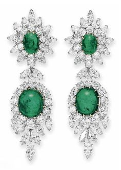 A PAIR OF EMERALD AND DIAMOND EAR PENDANTS, BY VAN CLEEF & ARPELS   Each suspending a detachable cushion-shaped cabochon emerald pendant, within a circular, marquise and pear-shaped diamond surround with articulated marquise-cut diamond fringe, to the surmount of similar design, mounted in platinum and 18k gold, 1968, with French assay mark and maker's mark, in a Van Cleef & Arpels blue suede case  Signed Van Cleef & Arpels, N.Y., no. 39374