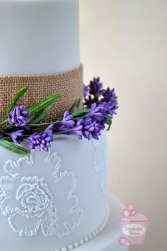 Wedding cake with ombre ruffles, sugar lavender garland, topped with a sugar David Austin rose. Lace brush embroidery inspired by bride's Blue by Enzoani Dillon wedding dress.