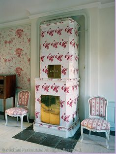 Love, love the red and white tiled fireplace!