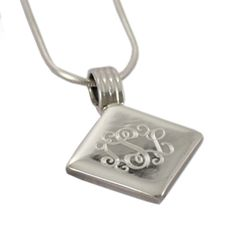 Monogrammed sterling silver pendant on silver chain