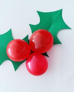 A giant sprig of holly made from construction paper and red balloons to decorate for your next holiday party! Grinch Christmas Party, Office Christmas Decorations, Christmas Balloons, Christmas Holidays, Christmas Crafts, Church Christmas Craft, Holly Christmas, Xmas, Christmas Activities