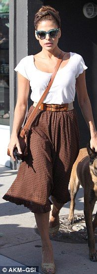 Eva's Mendez fashion formula: A flowing skirt cinched in at the waist is the star's flattering go-to style and can be tweaked for day or night looks