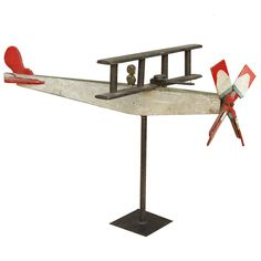 c. 1930's Large Wooden Folk Art Plane | From a unique collection of antique and modern sculptures and carvings at https://www.1stdibs.com/furniture/folk-art/sculptures-carvings/
