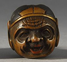 Lot 90: WOOD OJIME In the form of two masks depicting Daikoku and Ebisu. Some lacquer details. Diameter 16mm. - Eldred's | Invaluable