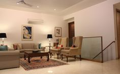 Living Room with beige sofas - Design by architect Amit Khanna, India