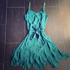 """*SALE!* Beautiful ruffled dress!! This dress is so pretty and sooo fun!  Sequined straps, lined, with waist tie, and the fun ruffles on bottom!  Almost has a flapper feel!  Size 12, but may fit 10, or even 8...  Too big on me, though (I'm 5'4"""", around 125lbs).  New w/o tags! Hi studio Dresses"""
