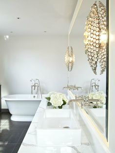 Suzie: Samantha Todhunter - Glam bathroom with freestanding tub, nickel wall-mount shower kit, ...