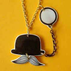 Mr Britain and monocle pendant gold