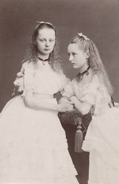 Princess Augusta Viktoria of Schleswig Holstein (right), later Kaiserin of Prussia, with sister Carolina Mathilde. Eafly 1870s